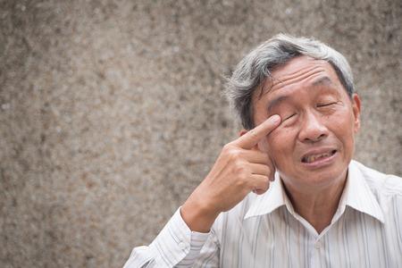 old man with eye irritation, optical problem