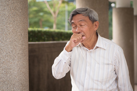 sick senior man coughing 스톡 콘텐츠