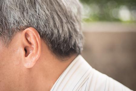 ear of senior old man, listening, hearing concept