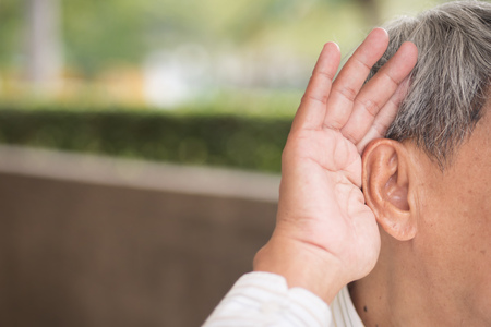 senior old man listening Stock Photo