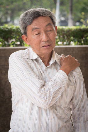 senior man suffering from elbow joint pain or injury or stiffness Stock Photo