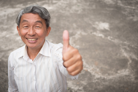 senior man thumb up gesture, accepting approving old man portrait