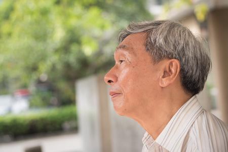 sad depressed old man, hopeless negative retired male senior face portrait