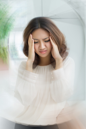 sick stressed dizzy woman suffering from vertigo, dizziness, headache Foto de archivo
