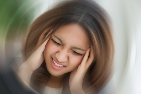 sick stressed dizzy woman suffering from vertigo, dizziness, headache Stockfoto