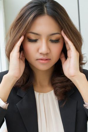 sick headache woman massaging her head, pain relief