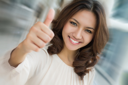 business woman giving thumb up gesture