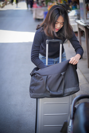 sad, negative woman traveler or tourist getting lost her money, belongings, passport due to pickpocketing or theft during travel, having bad travel experience