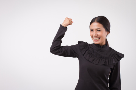 happy smiling excited woman portrait looking; surprised laughing happy woman, smiling girl looking studio isolated; woman looks up, smiles with happy joyful cheerful face expression; asian woman model