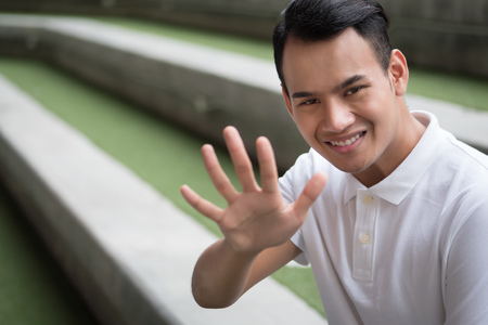 happy man pointing up five finger gesture; smiling friendly man pointing 5 number, number five fingers hand sign; guy points up number five hand sign concept of counting, numbering