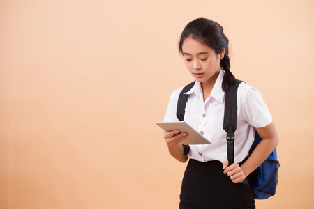 asian thai college woman student; education portrait of serious, stressed university woman student carrying backpack and computer tablet; concept of college student education, university education