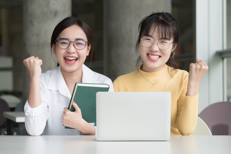 Successful woman college students get back to school; portrait of confident woman students studying in college; education success, fall or winter back to school concept; asian young adult woman model Archivio Fotografico