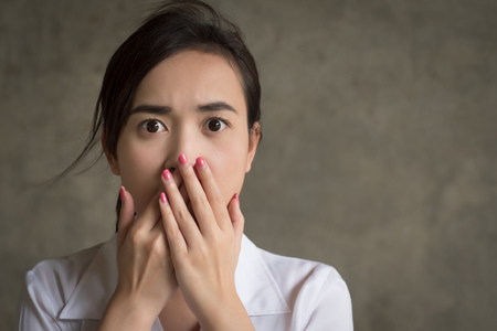 A woman with shocking mood; portrait of shocked, stunned, fear, scared Asian woman
