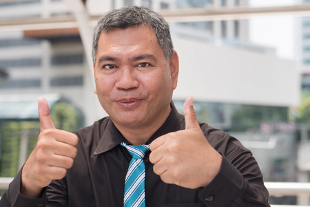 double thumbs up from successful old business man