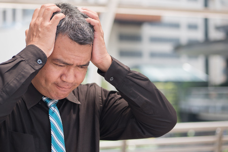 thoughtful old man thinking, stressful senior man planning; portrait of stressed, serious, hopeless, desperate asian man thinking, planning with headache Stock Photo