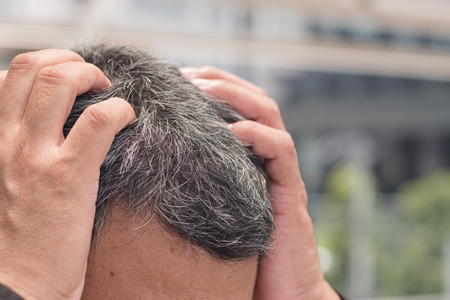 old asian senior man head with grey hair suffering from headache Stock Photo