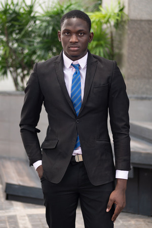 serious and confident african businessman; portrait of confident, successful african  business man, manager, business executive CEO; young adult african man model