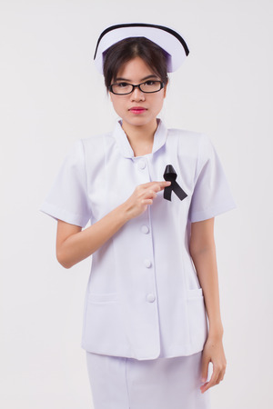 woman nurse hand holding black ribbon bow, sad unhappy mourning woman, studio white isolated of asian young adult model