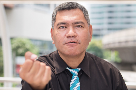 angry middle aged business man looking at you, portrait of aggressive asian businessman expression. Concept of business problem, unemployment, lay off, depression. asian 50s old man model