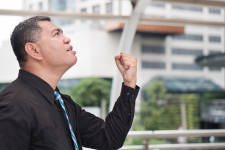 Angry middle aged business man shouting up. Portrait of frustrated, upset asian businessman shouting or screaming. Business problem, unemployment, lay off, depression concept. asian 50s old man model Stock Photo