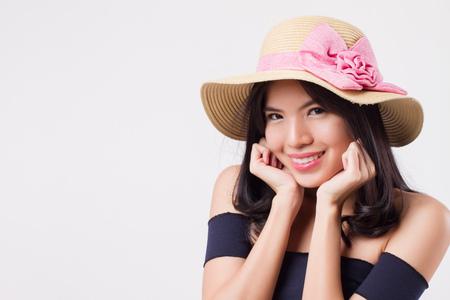 happy smiling woman wearing summer travel hat. portrait of positive optimistic woman traveler. Stock Photo