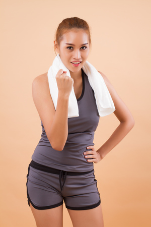 happy smiling asian woman doing fitness aerobic exercise; portrait of strong confident woman fitness training, workout, exercising for healthy lifestyle concept; tan skin asian woman model Stock Photo
