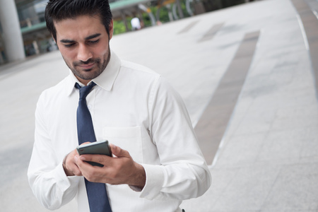 unhappy asian business man using smart phone; portrait of unhappy sad failed Asian, north indian businessman using smart phone for app, internet connection technology, bad internet connection concept