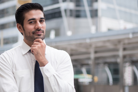 asian business man thinking; portrait of Asian, north indian successful and confident businessman thinking, planning, looking, having future project Stock Photo