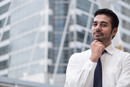 thoughtful asian business man thinking and looking at you; portrait of Asian, north indian successful and confident businessman thinking, planning, looking, having future project