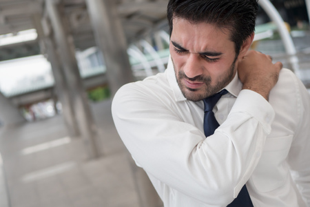 Sick unhealthy asian man suffering from shoulder pain, stiff shoulder, arthritis, gout, office syndrome