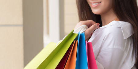 shopping asian girl; portrait of exited, surprised, happy smiling woman shopper; Asian Chinese woman holding shopping bag, concept of sale, travel and shopping, consumer, good economic, banner crop