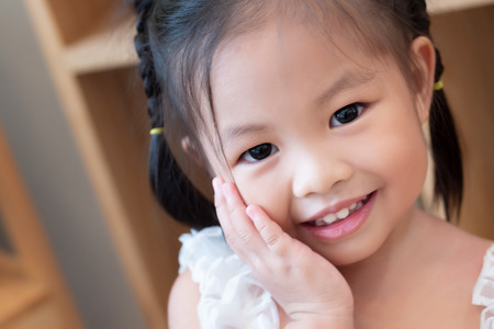 portrait of happy smiling positive asian child, cute little girl