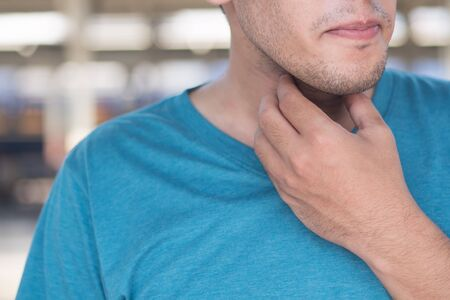 sick man getting a cold or flu with sore throat, congested throat with phlegm