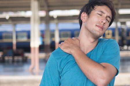 man suffer from stiff shoulder, muscle inflammation