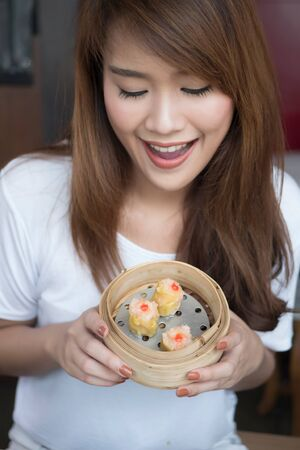 woman eating Chinese Hong Kong dim sum