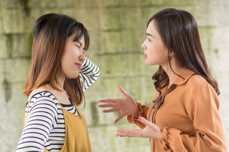 two women having conflict, arguing each other