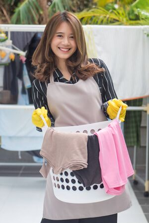 happy woman holding laundry basket Reklamní fotografie