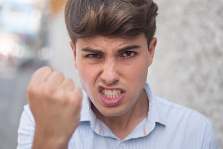 angry aggressive man threatening you with his fist