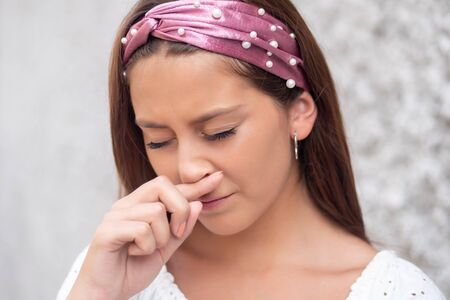 sick woman suffering from runny nose, allergy, flu Stockfoto