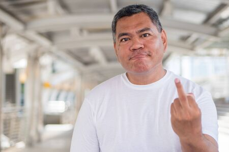 angry old man showing rude, vulgar middle finger gesture