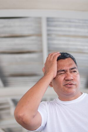 sick asian senior man suffering from headache, stress, depression, Alzheimer