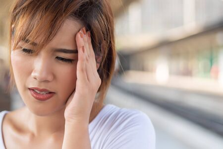 depressed woman suffering from headache, stress, depression, burnout; health care concept Stock Photo