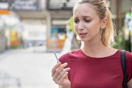 determined woman trying to quit smoking and breaking her cigarette, concept of no smoking, stop smoking, health care, healthy lifestyle without tobacco and cigarette Stock Photo