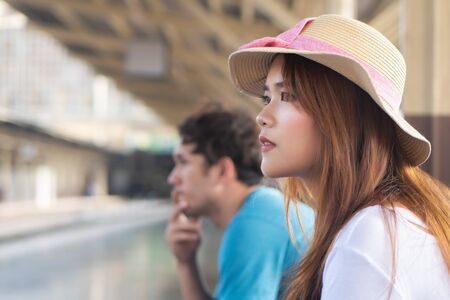 woman traveler waiting for train; new adventure, summer vacation, public transportation, budget travel, comfortable travel, girl traveler on long vacation, stress management, outdoor activity concept
