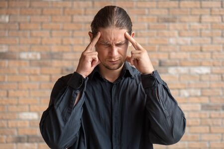 sick man with headache or fever; concept of flu sickness, influenza, cold, high fever