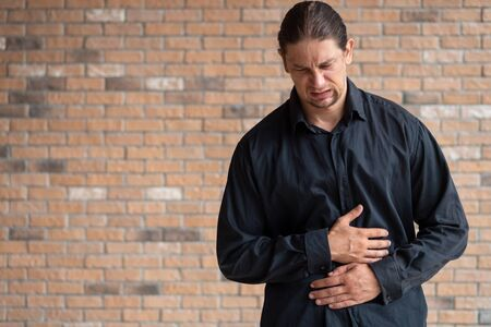 sick man suffering from stomachache; concept of stomachache, stomach cancer, intestinal gastric cancer, indigestion, constipation, food poisoning, diarrhea, flatulence, body care, man health care
