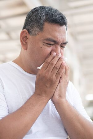 allergic sick old man sneezing flu; concept of man with coronavirus covid-19 infection spreading the disease, allergy, sore throat or lung inflammation, pneumonia, influenza, flu, cold, sickness