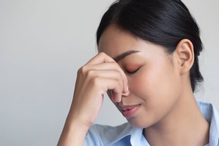sick woman having headache or fever due to virus infection; concept of health care, disease quarantine, coronavirus outbreak, sickness containment, pandemic, endemic, COVID-19 coronavirus infection