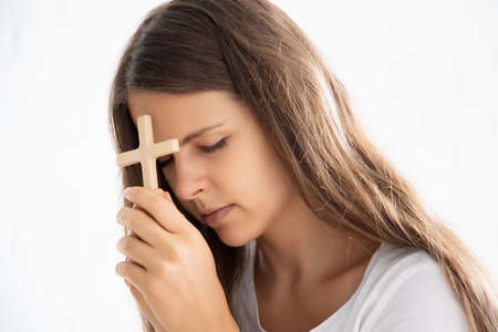 religious christian woman disciple praying to god with holy cross Stock Photo