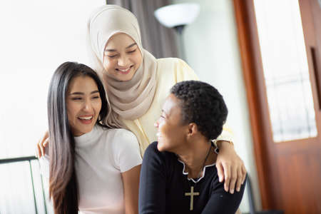 A group of multi ethnic friends, multi racial women with different religions; concept of people with diversity and inclusivity